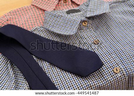 couple of man's shirts and blue necktie - stock photo