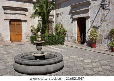 Courtyard and fountain in a historic Spanish style colonial house in Arequipa, Peru. The building now houses the Regional Library Mario Vargas Llosa                                - stock photo