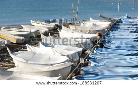 Covered boats preserved on the beach, in the Ligurian village of Lavagna, Italy. - stock photo