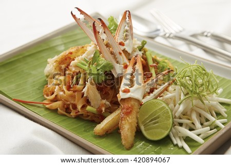Crab pad Thai dish of stir fried rice noodles. - stock photo