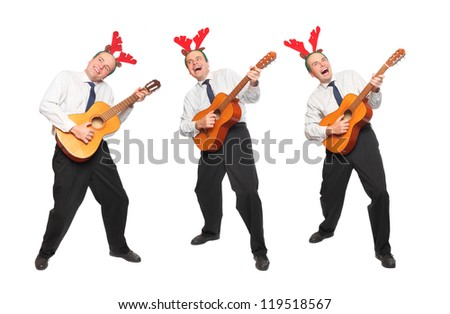 Crazy musicians in business suit with guitar singing. Christmas and new year party concept. - stock photo