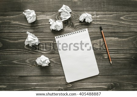 creativity concept, notepad, pencil and crumpled paper, flat lay - stock photo