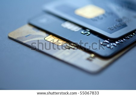 credit cards on a blue background, selective focus. closeup. - stock photo