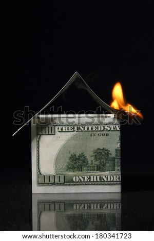 crisis, House made with One hundred dollars in fire, burning dollar - stock photo