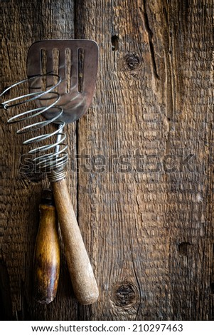 Culinary background with kitchen utensils on wooden table - stock photo