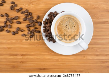 cup of coffee on brown background - stock photo