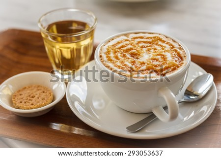 Cup of hot  milk art coffee and tea  - stock photo
