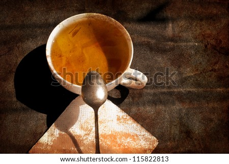 cup of tea on brown vintage background with grunge texture - stock photo