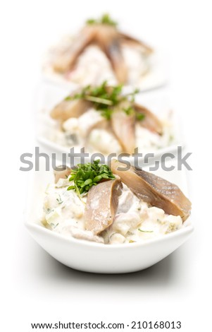 3 cups young herring salad isolated on white background - stock photo