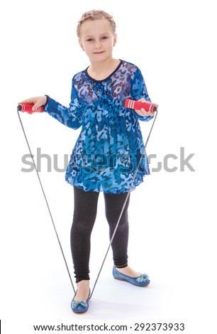 Cute cheerful girl with a yellow skipping rope in your hands- isolated on white background - stock photo