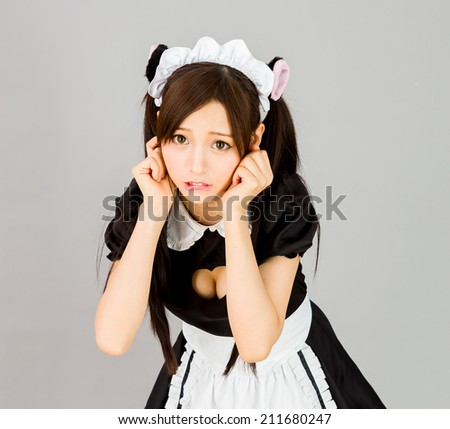 cute girl maid in gray background japanese style big boods - stock photo