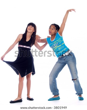 2 cute girls with different ethnic backgrounds praising a great product - stock photo