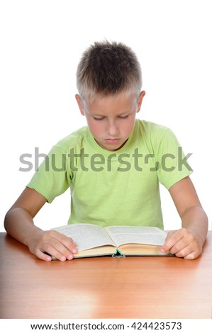 Cute pupil thinking at desk in classroom at the elementary school - stock photo