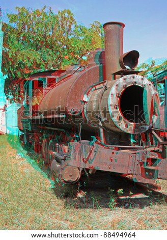 3D anaglyph stereo image of destroyed old-time locomotive. Havana,cuba. To view this image you need stereo glasses. - stock photo