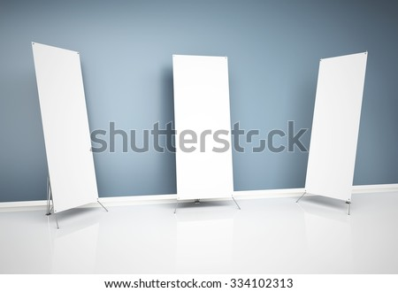 3d blank roll-up banners near wall - stock photo
