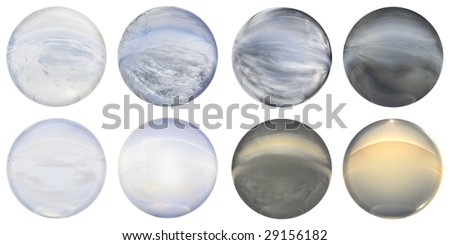 3d blue,brown,grey and yellow glass spheres set or collection  isolated on white background,ideal for 3D symbols, signs or web buttons. It is a sphere reflecting a blue sky with clouds - stock photo