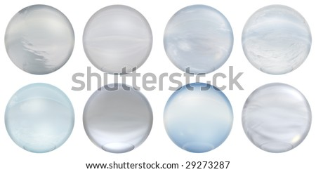 3d blue glass spheres group or collection isolated on white background,ideal for 3D symbols, signs or web buttons. They are spheres reflecting a blue sky with clouds - stock photo
