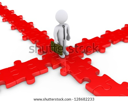 3d businessman is on a puzzle crossroad wondering for the right path - stock photo
