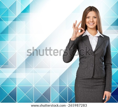 3d. Businesswoman with big 3d chart showing ok gesture - stock photo