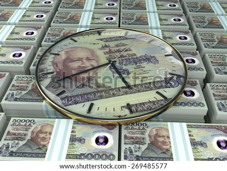3D clock on piles and stack of Indonesia money - stock photo