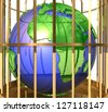 3d Earth globe in golden cage - stock photo