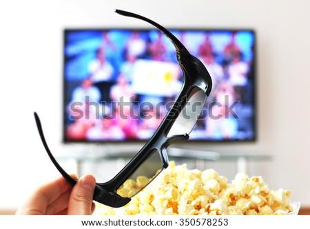 3D glasses against TV-set - stock photo