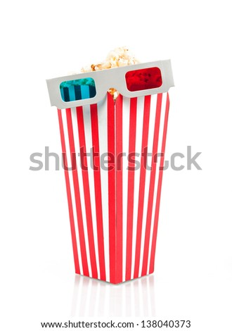 3D glasses on top of the popcorn bucket - stock photo
