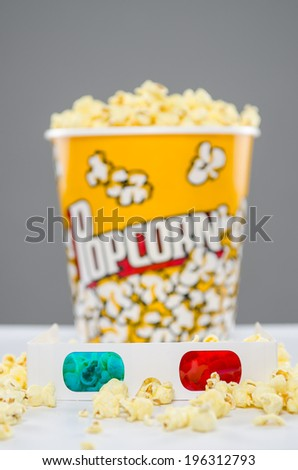 3d glasses with bucket of popcorn in back - stock photo