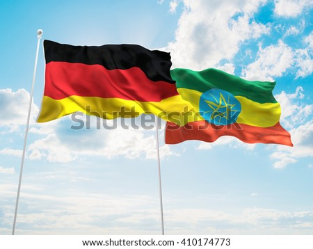 3D illustration of Germany & Ethiopia Flags are waving in the sky - stock photo