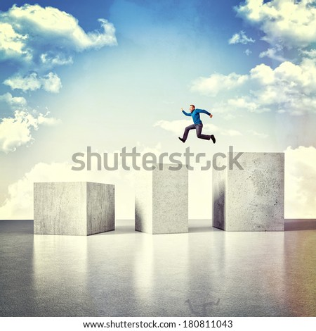 3d image of huge concrete block and jumping man - stock photo