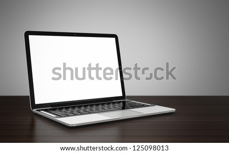 3D image of modern laptop with blank screen on wooden table next to gray wall - stock photo