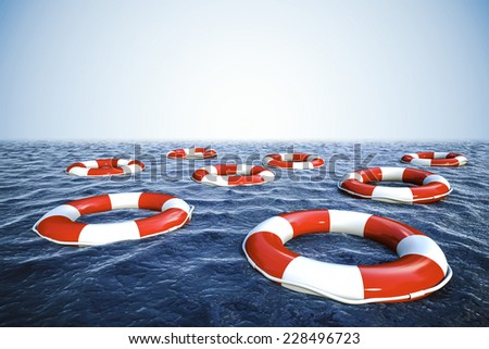 3d life buoys and blue ocean with blue sky background - stock photo