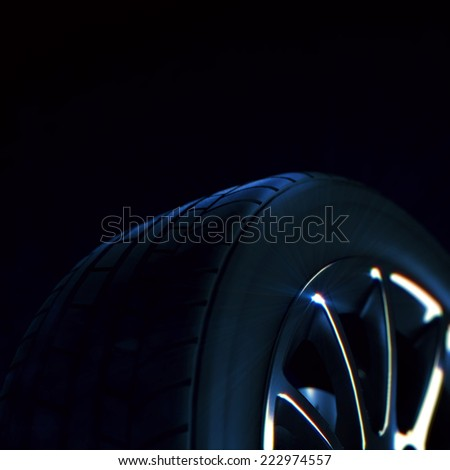 3d macro illustration of a car tire with depth of field blur on black background. Selective focus. - stock photo
