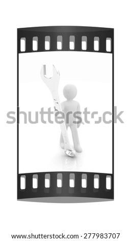 3d man - wrench in hands on a white background. The film strip - stock photo