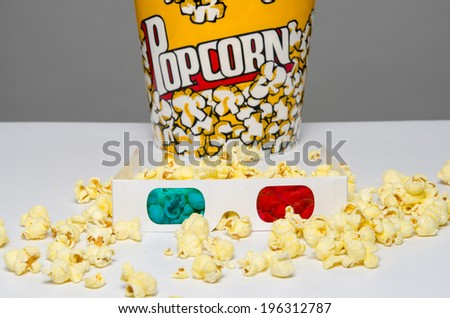 3d movie glasses and popcorn - stock photo