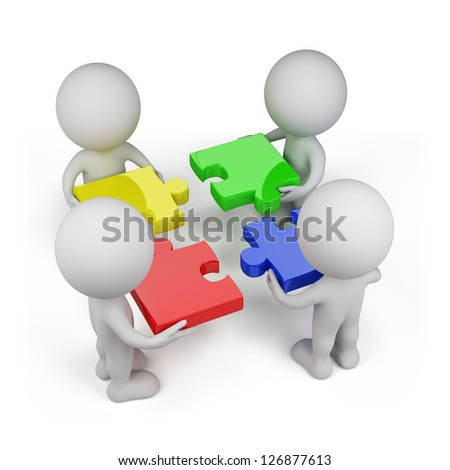 3d person - team with colored puzzles. Isolated white background. - stock photo