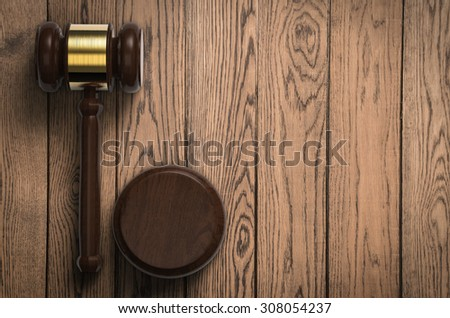 3d rendered gavel judge on wooden background - stock photo