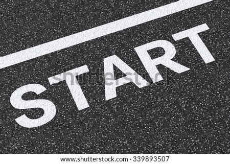 3d rendered start text on asphalt road - stock photo