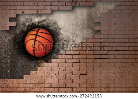 3d rendering of a basket ball embedded in a brick wall - stock photo
