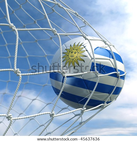 3d rendering of a Uruguayan soccer ball in a net - stock photo