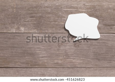3d rendering of blank white speech bubble on wooden background - stock photo