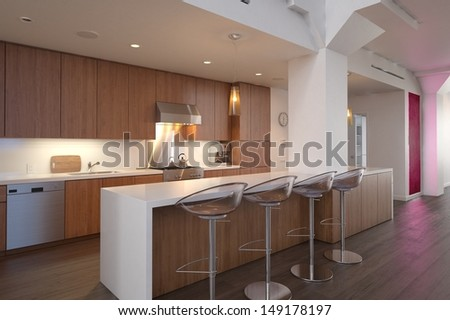 3D rendering of modern kitchen interior with counter and bar stools.  - stock photo