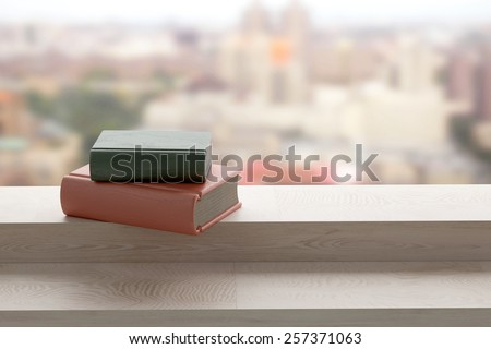 3d rendering of old books on a window - stock photo