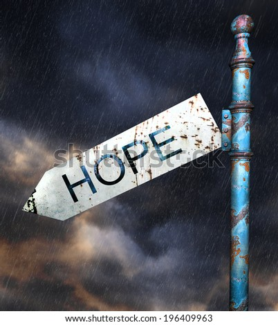 3d Rusted grunge road sign over dramatic sky and rain, concept for desperation and hopelessness. - stock photo