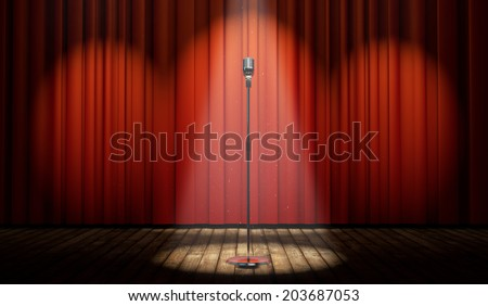 3d stage with red curtain and vintage microphone in spot light, with magical particles   - stock photo
