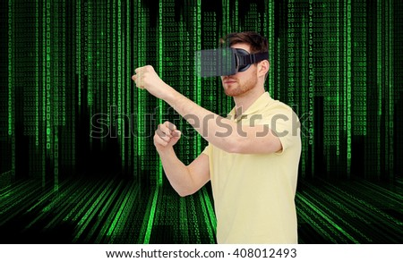 3d technology, virtual reality, entertainment and people concept - young man with virtual reality headset or 3d glasses playing game and fighting over binary code background - stock photo