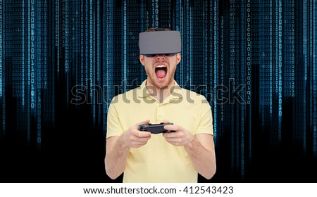 3d technology, virtual reality, entertainment and people concept - young man with virtual reality headset or 3d glasses playing with game controller gamepad and screaming over binary code background - stock photo