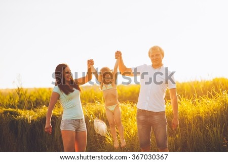 dad mom daughter family outdoor recreation - stock photo