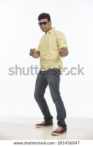 Dancing Indian young boy in casual on white background. - stock photo