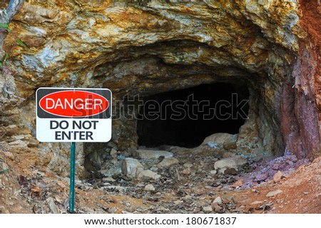 """""""Danger"""" Do Not Enter Sign at the Entrance of an Abandoned Gold Mine - stock photo"""
